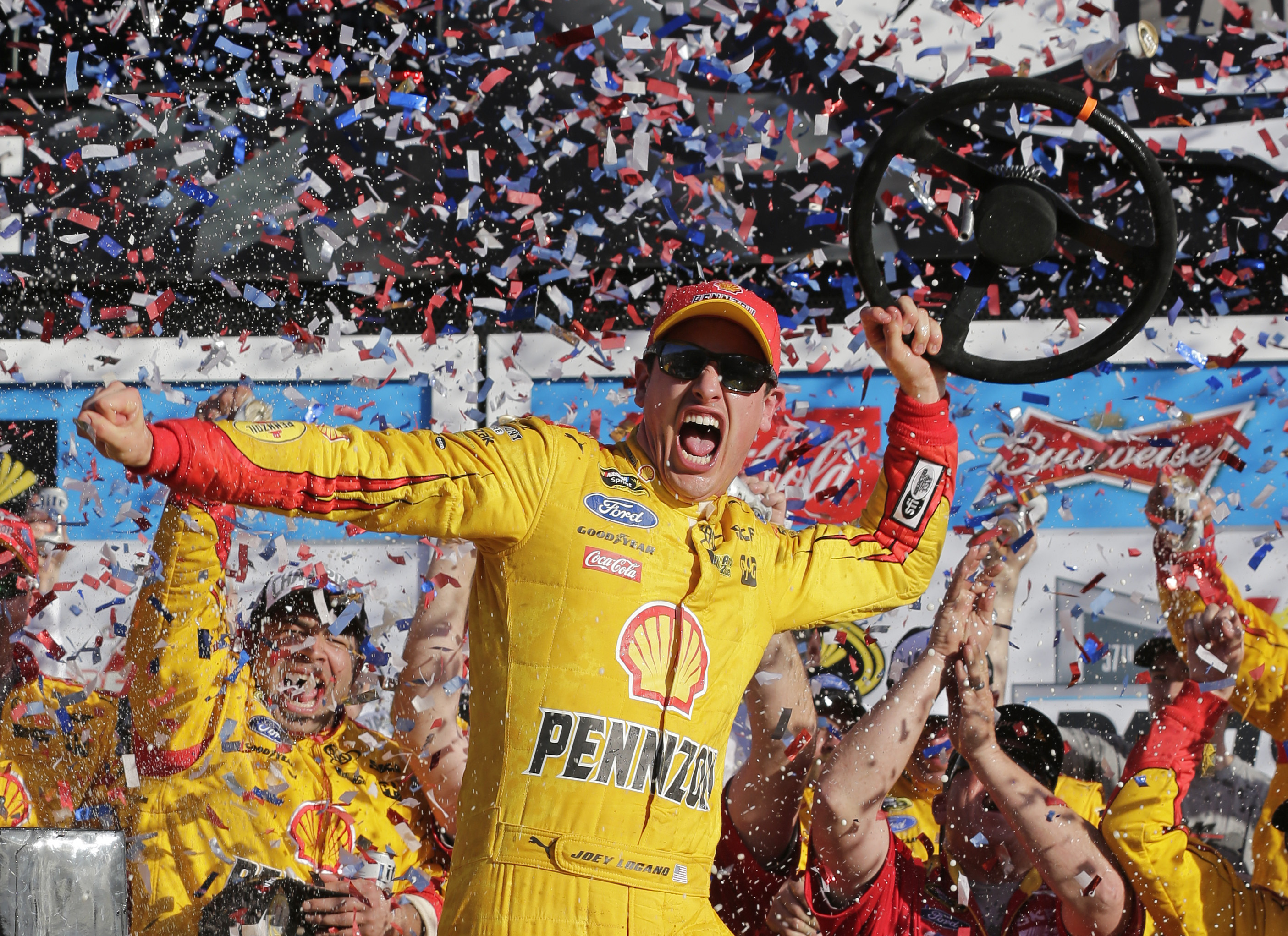 Joey Logano celebrates after winning the Daytona 500. (AP)