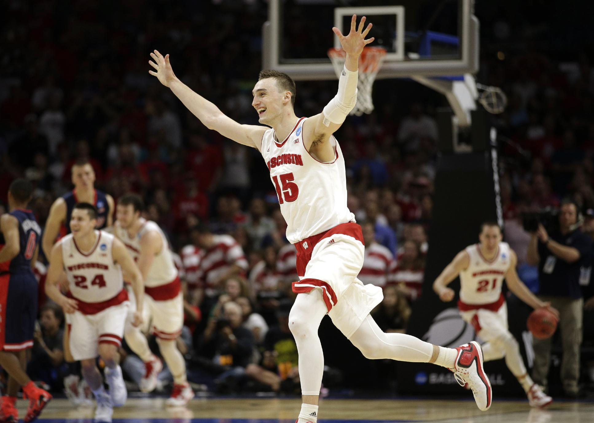 Wisconsin forward Sam Dekker (15) celebrates after Wisconsin beat Arizona 85-78 in a college basketball regional final in the NCAA Tournament, Saturday, March 28, 2015, in Los Angeles. Wisconsin advances to the Final Four in Indianapolis. (AP Photo/Jae C. Hong)