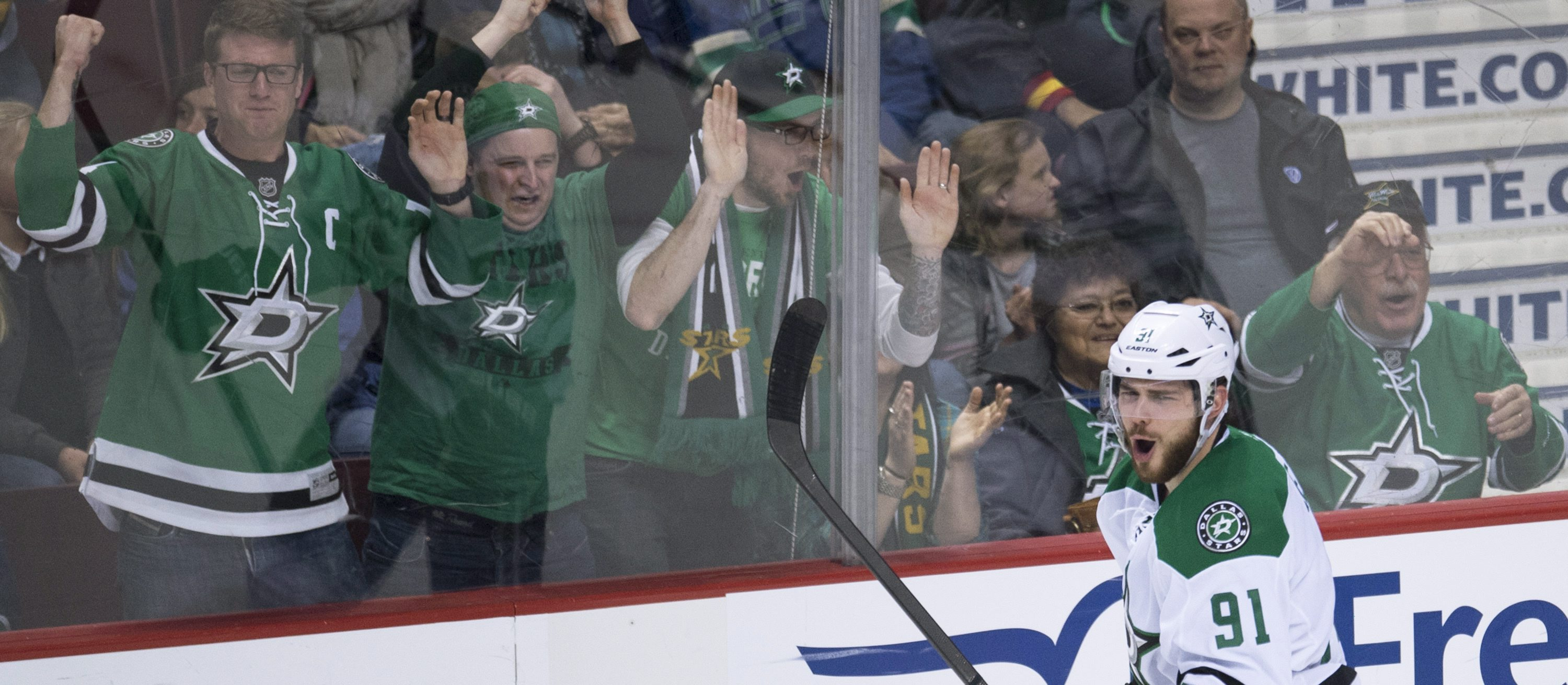 Dallas Stars center Tyler Seguin (91) celebrates his goal against the Vancouver Canucks during the third period of an NHL hockey game Saturday, March 28, 2015, in Vancouver, British Columbia. (AP Photo/The Canadian Press, Jonathan Hayward)