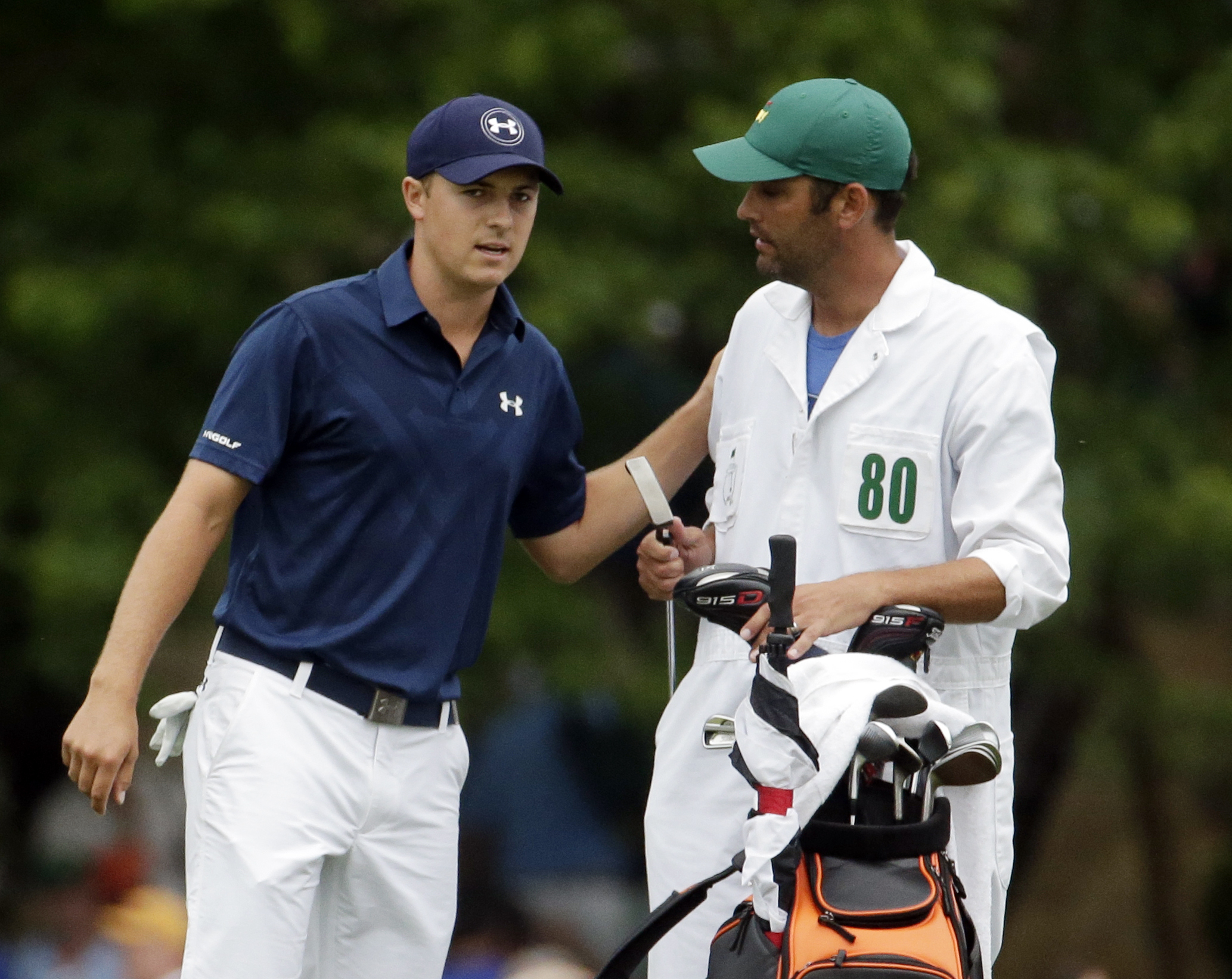 Jordan Spieth speaks with his caddie Michael Greller on the 15th hole during the fourth round of the Masters golf tournament Sunday, April 12, 2015, in Augusta, Ga. (AP Photo/Charlie Riedel)