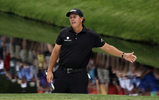 Phil Mickelson reacts after hitting onto the 16th green. (AP)