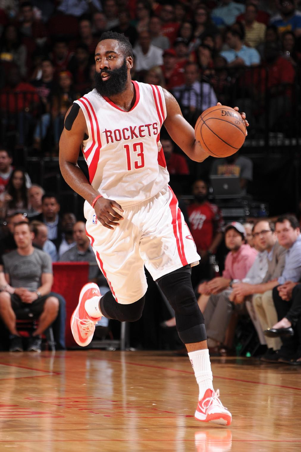 HOUSTON, TX - APRIL 15: James Harden #13 of the Houston Rockets handles the ball against the Utah Jazz on April 15, 2015 at the Toyota Center in Houston, Texas. (Photo by Bill Baptist/NBAE via Getty Images)