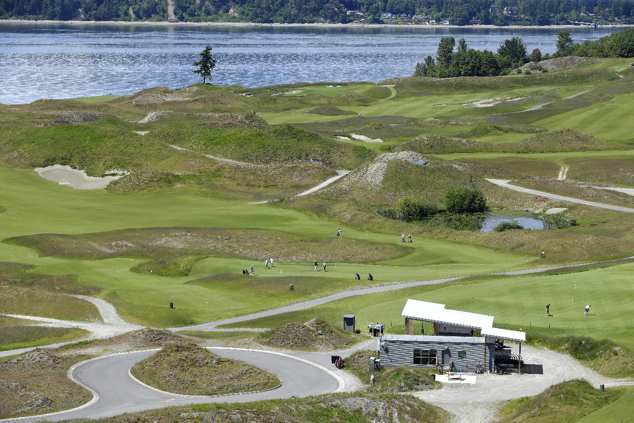 Chambers Bay Golf Course, including the signature lone tree, is seen from the clubhouse in University Place, Wash. (AP)