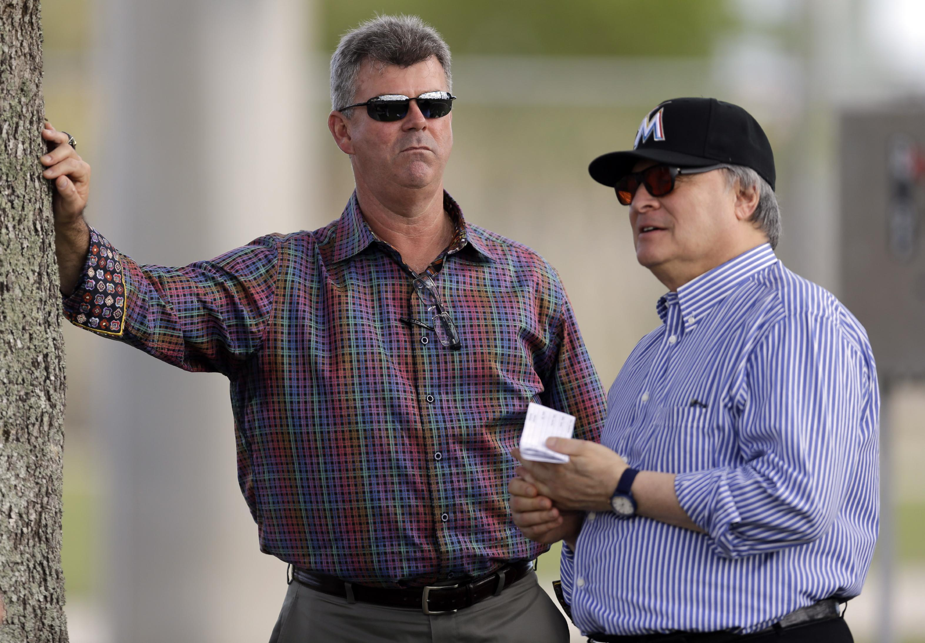 New Marlins manager Dan Jennings (left) and owner Jeffrey Loria. (AP)