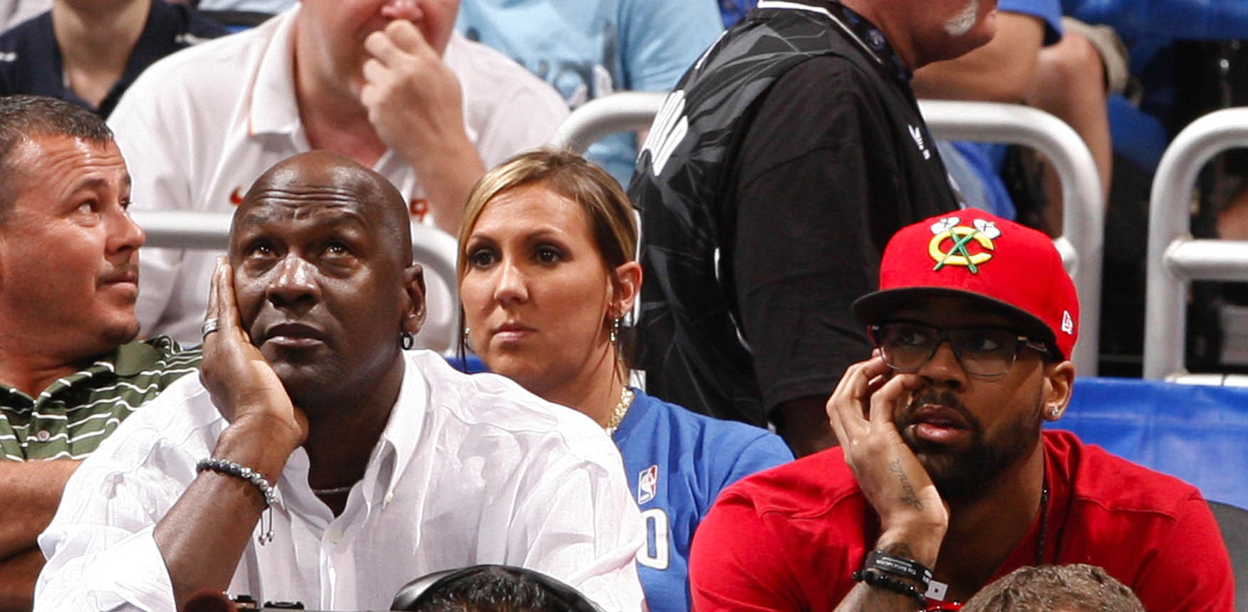 Michael Jordan watches the game against the Orlando Magic with his son Marcus in 2011. (Getty Images)