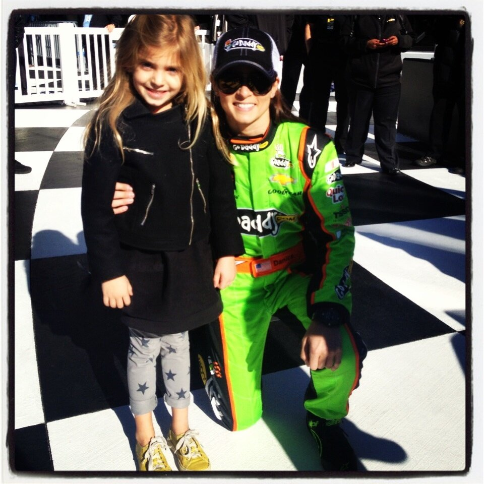 Danica Patrick poses with Jeff Gordon's daughter, Ella. (Ingrid Vandebosch via Twitter)