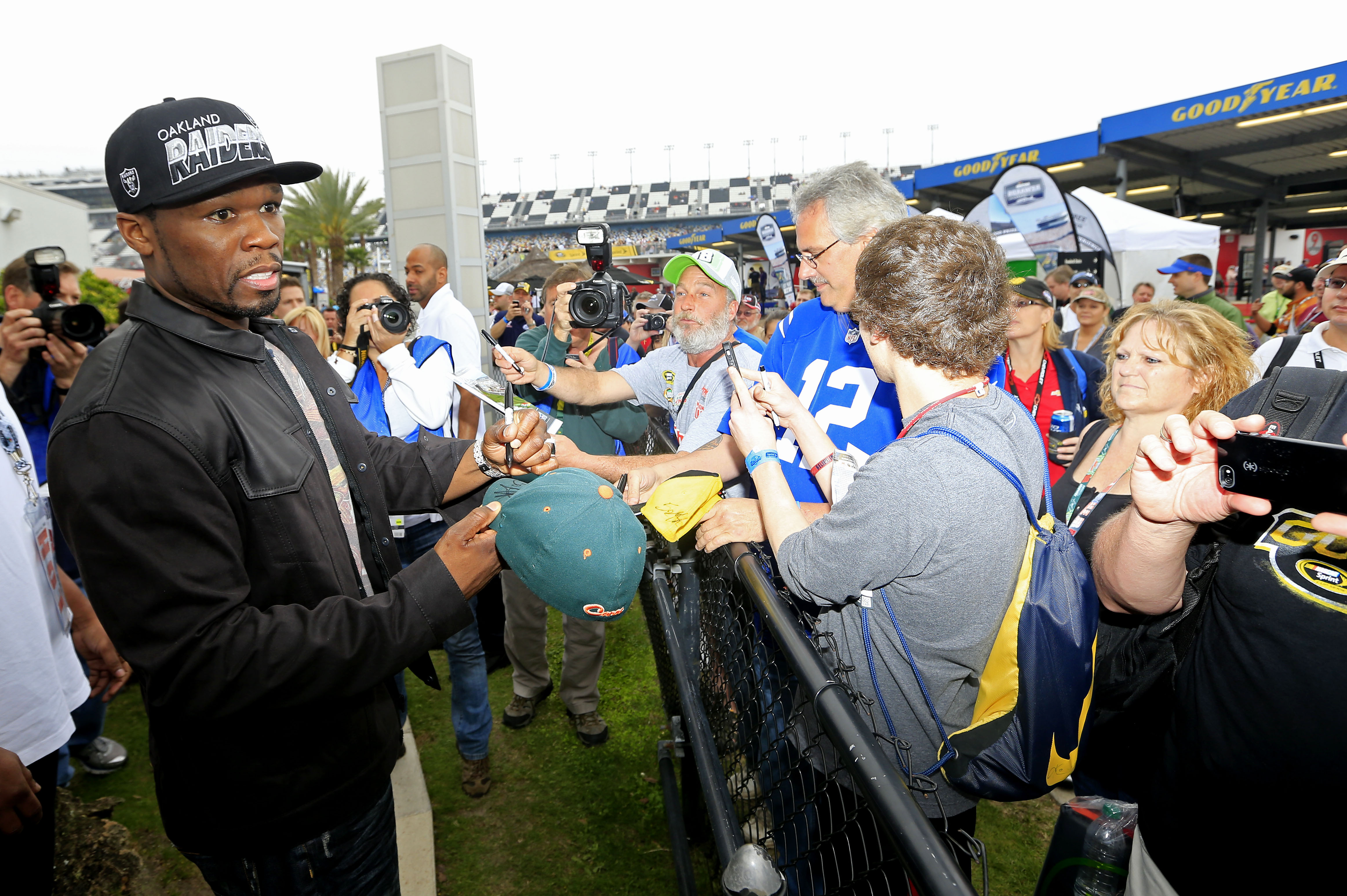 "Rapper Curtis ""50 Cent"" Jackson signs autographs prior to the Daytona 500. (Getty Images)"