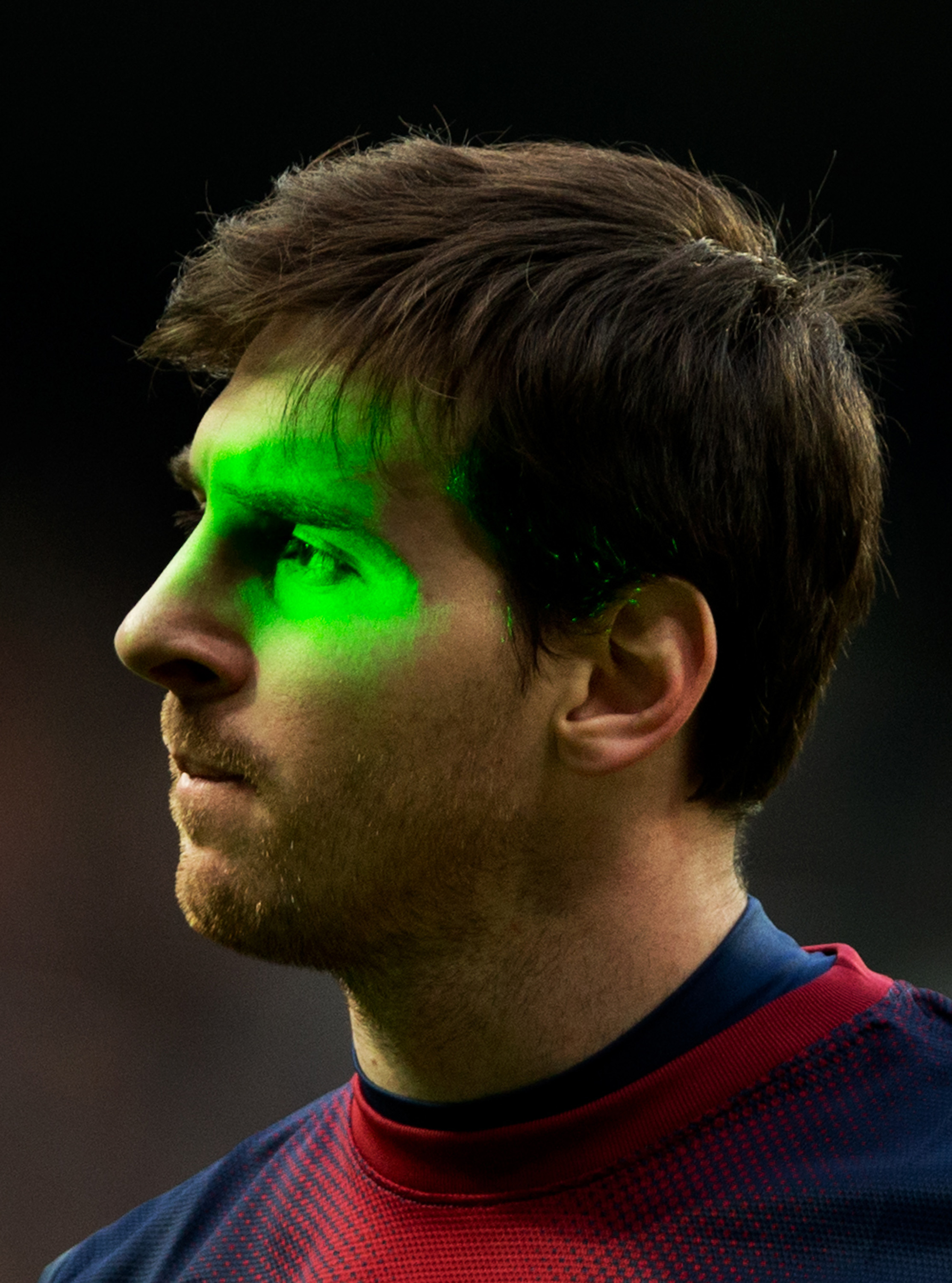 Lionel Messi is illuminated by laser during the match between Real Madrid and Barcelona. (Getty Images)