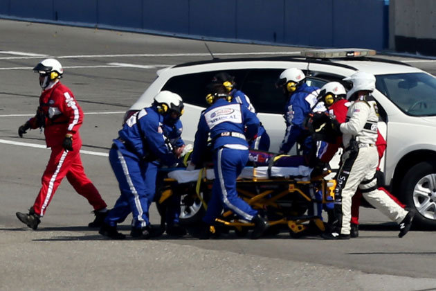 Denny Hamlin is placed on a stretcher after a hard wreck at Auto Club Speedway. (Getty Images)