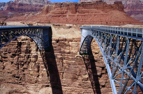 The Navajo Bridge, old and new across the Grand Canyon in Arizona. The steel arch bridge was completed in 1929 and is 834 ft long, and 467 feet above the water and Marble Canyon.