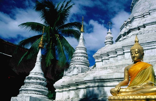 Large gilded statue of a sitting Buddha in Wat Phra Thong, inner Ko Phuket