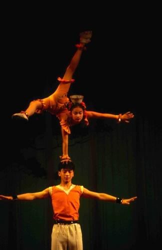 Acrobats perform a balancing act at Lyceum Theater