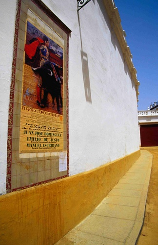 A poster advertising a bullfight at the Plaza de Toros de la Real Maestranza, one of the oldest and most spectacular bullrings in Spain