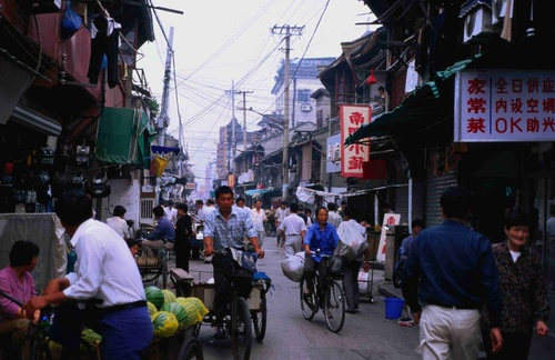 Street close to the Yu Yuan Bazaar, crowded with hawkers and bicycles