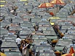 Taxis queue up outside Beijing railway station.(AFP/Peter Parks)