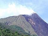 Karangetang volcano spews smoke in Siau island. (AFP/File)