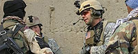 In this undated photo provided by the U.S. Army, Capt. Kyle Walton, right, and Master Sgt. Scott Ford, left, talk to an interpreter in Eastern Afghanistan. Both men will recieve a Silver Star Friday, Dec. 12, 2008 in the largest Special Forces award ceremony since the Vietnam War. (AP Photo/U.S. Army Photo, Sgt. David N Gunn)