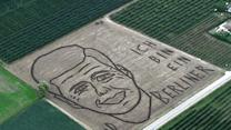 Raw: Artist Ploughs JFK Image in Field