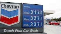 Exxon & Chevron weigh on Dow; LinkedIn fails to hide issues; Expedia soars
