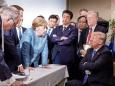 This G7 Summit Photo Of Angela Merkel & Donald Trump Is Meme-Worthy AF