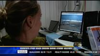Scientists study beach erosion during stormy weather