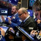 Wall St. rises as bank, healthcare stocks gain