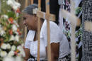 The Latest: Sri Lanka revises down death toll from attack