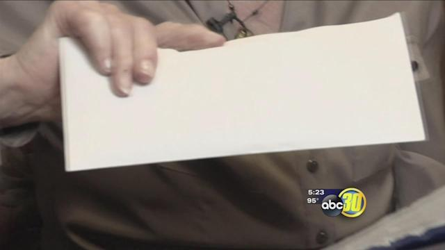 Safe from Scams: Filling envelopes for money