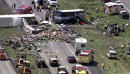 The Latest: 2 sue trucking company after deadly bus crash