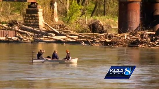 Kayakers rescued from log jam
