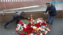 Russians March to Mourn Slain Leader
