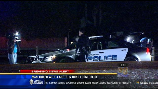 Man armed with a shotgun runs from police in North County