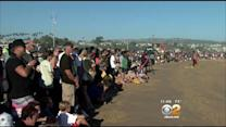 Huge Waves Continue To Draw Enthusiastic Crowds In Newport Beach