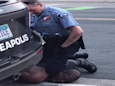 'Please, I can't breathe': US police officer filmed with knee on neck of motionless man who later died