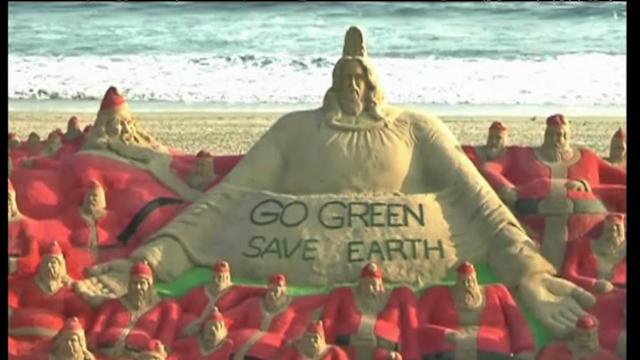 Indian sand artists create over 500 Santa sculptures in world record attempt