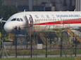 A pilot for Sichuan Airlines was partially sucked out of a plane after the front windshield broke