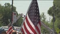 Hundreds of strangers line streets to show support for fallen soldier Spc. Zachary (Zack) Shannon
