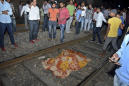 Train mows down crowd at India festival, at least 58 dead