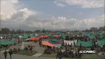 Nepalese camp outdoors after quake