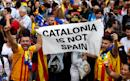 EU warns 'more cracks' in bloc as Spain dissolves Catalonia's parliament after it declares independence