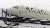 Delta plane skids off icy NYC runway