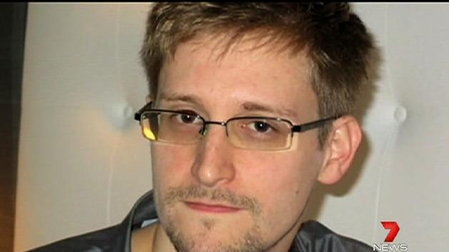 Former spy Snowden still in transit