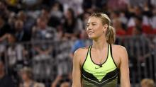 Sharapova back in business, like it or not