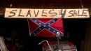 Man Posts 'Slaves 4 Sale' Sign Next To Confederate Flag To Prove He's No Racist