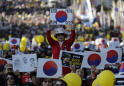 Pro-government protesters rally in Seoul to support minister