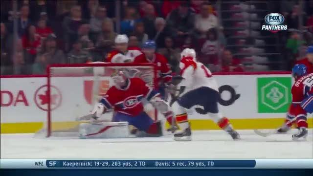 Jesse Winchester gets puck past Peter Budaj