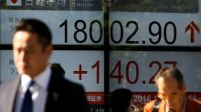 World stocks rise on French vote relief, Trump tax plan talk