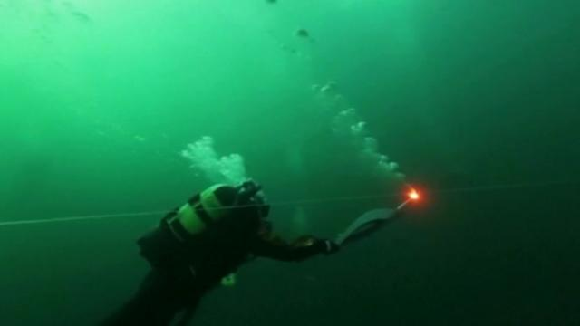 Sochi Olympic Torch reaches bottom of world's deepest lake