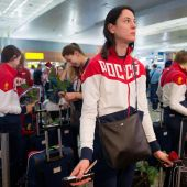 Russia's depleted Olympic squad leave Moscow for Rio