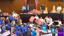 Taiwanese lawmakers launch water balloons, brandish chairs in floor brawl